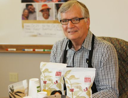 Gordon Potts, co-organizer of the Simcoe Ten Thousand Villages Festival Sale, shows off some of the fair trade food products that will be available at the sale at First Baptist Church Friday and Saturday. SARAH DOKTOR/Simcoe Reformer
