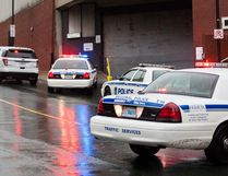 Police cars block traffic at the Scotiabank Centre in Halifax on Thursday Oct. 23, 2014. Police in Halifax have made an arrest and recovered a gun in the downtown core after receiving a report of a man with a rifle in the downtown core Thursday morning. (Scott Blackburn/QMI Agency)