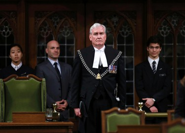 Canada's Sergeant-at-Arms Kevin Vickers is applauded in the House of Commons in Ottawa October 23, 2014. Vickers shot a gunman during an attack on the Parliament Buildings on October 22. REUTERS/Chris Wattie (CANADA  - Tags: POLITICS CRIME LAW)