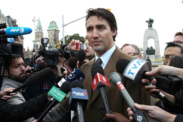 Liberal Party of Canada leader Justin Trudeau talks to the media after laying a wreath at the Canadian War Memorial in Ottawa the day after a soldier was murdered. Thursday October 23, 2014. Errol McGihon/Ottawa Sun/QMI Agency