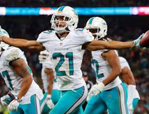 Miami Dolphins' Brent Grimes celebrates an interception against the Oakland Raiders during their NFL football game at Wembley Stadium in London, September 28, 2014. (REUTERS)