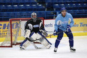Sudbury Wolves forward Nick Baptiste sets up in front of netminder Troy Timpano during practice at Sudbury Community Arena on Thursday afternoon. Baptiste will make his season debut Friday against Peterborough.