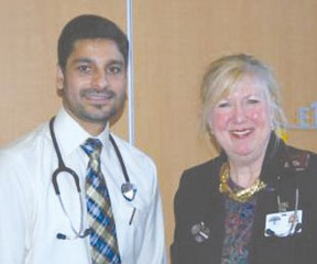 Dr. Laurel Moore (R) welcomes Dr. Yad Dhillon (L) to the HPHA.