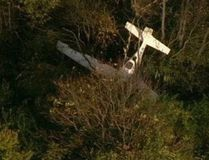 The wreckage of a Cirrus SR 22 airplane is shown in this handout photo courtesy of WBAL-TV/SkyTeam11, near Frederick Municipal Airport in Frederick, Maryland October 23, 2014. REUTERS/WBAL-TV/Skyteam11/Handout via Reuters
