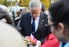 NDP MP Charlie Angus waits to lay flowers at the National War Memorial in Ottawa on Thursday, Oct. 23, 2014, where a solider was shot and killed Matthew Usherwood/ QMI Agency