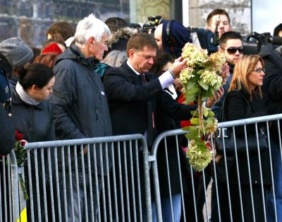 A man leaves flowers near the Canadian War Memorial in Ottawa the day after a soldier was murdered. Thursday October 23, 2014. Errol McGihon/Ottawa Sun/QMI Agency
