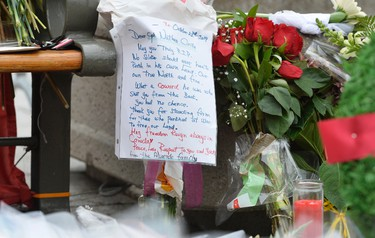 Flowers placed by mourners lay at the National War Memorial in Ottawa on Thursday, Oct. 23, 2014, where a solider was shot and killed in Ottawa. Matthew Usherwood/QMI Agency