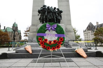 A wreath laid by Canada's Minister of National Defence Rob Nicholson stands in front of the Tomb of the Unknown Soldier at the National War Memorial in downtown Ottawa October 23, 2014. A gunman attacked Canada's parliament on Wednesday, with gunfire erupting near a room where Prime Minister Stephen Harper was speaking, and a soldier was fatally shot at a nearby war memorial, jolting the Canadian capital.         REUTERS/Blair Gable     (CANADA - Tags: POLITICS MILITARY CRIME LAW)