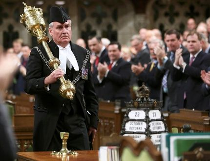 Sergeant-at-arms Kevin Vickers is applauded in the House of Commons in Ottawa October 23, 2014. (REUTERS/Chris Wattie)