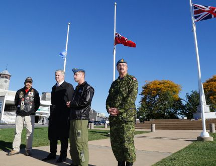 Graeme Hume of the Highway of Heroes Ride, CFB Trenton base commander Col. David Lowthian, with Quinte West Mayor John Williams and CFB Trenton acting chief warrant officer Jean Lafond remember the deaths of two Canadian soldiers killed on home soil this week – Cpl. Nathan Cirillo and WO Patrice Vincent. A ceremony was held at the Cenotaph in Trenton, ON., Friday, Oct. 24, 2014. Emily Mountney-Lessard/The Intelligencer/QMI Agency