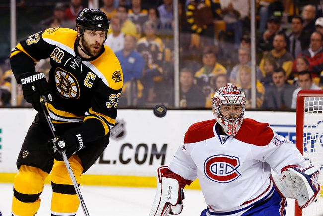 Montreal Canadiens goalie Carey Price (31) and Boston Bruins defenceman Zdeno Chara (33) eye a loose puck during Game 7 of their second-round playoff series at TD Garden. (Winslow Townson/USA TODAY Sports)