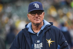 Tampa Bay Rays manager Joe Maddon (70) watches from the dugout during MLB action against the Oakland Athletics at O.co Coliseum. (Kyle Terada/USA TODAY Sports)