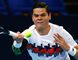 Milos Raonic returns the ball to David Goffin of Belgium during their match at the Swiss Indoors tennis tournament in Basel October 24, 2014.  (REUTERS/Arnd Wiegmann)