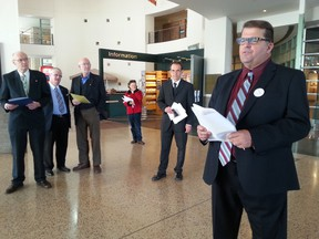 College ward candidate Guy Annable and his supporters at City Hall on Friday, Oct. 24, 2014 talk about their wish to have commuter trains to Kanata on an existing rail line. JON WILLING/OTTAWA SUN