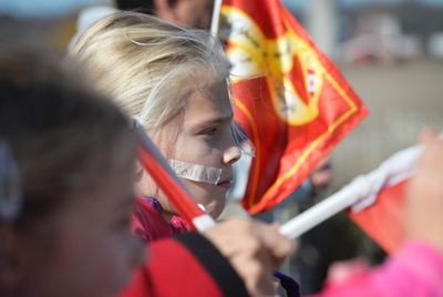 10 year old Marin Marrow waits to show her respect to the procession bringing the body of Cpl Nathan Cirillo back to his hometown of Hamilton, Ont., moves along Hwy. 401 just outside the town of Prescott, Ont., on Friday, Oct. 24, 2014. Cirillo was shot and killed earlier this week in Ottawa by a lone gunmen. Matthew Usherwood/ QMI Agency