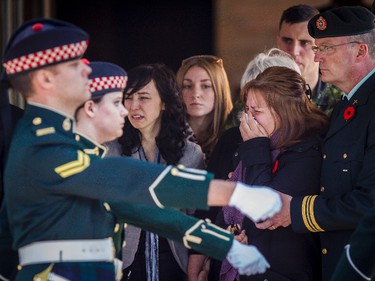 Kathy Cirillo (2nd R), the mother of Cpl. Nathan Cirillo, reacts after his casket was placed in a hearse at a funeral home in Ottawa October 24, 2014. Cirillo was killed during a shooting incident at the Canada War Memorial in Ottawa on October 22. October 24, 2014. Errol McGihon/Ottawa Sun/QMI Agency
