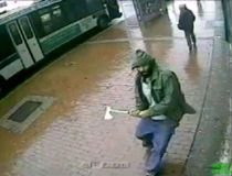 A man holding a hatchet is seen in a still image from surveillance video