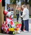 <p>People pay their respects to a memorial of flowers, cards and greetings at the home of slain soldier  Cpl. Nathan Cirillo in Hamilton, Ont. on Friday October 24, 2014. Ernest Doroszuk/Toronto Sun/QMI Agency