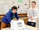 Jace Chicoine and Jack Taylor, Grade 10 civic students at Simcoe Composite School prepare to cast their votes for a mock election hosted by Student Vote that parallels the municipal election. In preparation, students have done extensive research on local candidates. Results from more than 1,600 schools in 254 municipalities across the province will be released following the Oct. 27 election. (SARAH DOKTOR Simcoe Reformer)