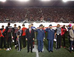 <p>Canada's Prime Minister Stephen Harper (centre-L) and Canada's Chief of the Defence Staff General Tom Lawson (centre-R) take part in a tribute to recently fallen Canadian soldiers, prior to a CFL football game between Ottawa Redblacks and Montreal Alouettes in Ottawa October 24, 2014. Corporal Nathan Cirillo and Warrant Officer Patrice Vincent both recently died during attacks in Canada. REUTERS/Blair Gable (CANADA - Tags: POLITICS MILITARY CRIME LAW SPORT FOOTBALL TPX IMAGES OF THE DAY)