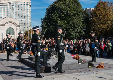 Sentries return to the Tomb of the Unknown Soldier during a ceremony at the National War Memorial in Ottawa October 24, 2014.  Canadian soldier Cpl. Nathan Cirillo was shot and killed at the National War Memorial on October 22,October 24, 2014. Errol McGihon/Ottawa Sun/QMI Agency