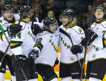 London Knights forward Aaron Berisha, centre, celebrates with his linemates after scoring one of his two first-period goals against the Ottawa 67's at Budweiser Gardens on Friday. The Knights won 5-2. (CRAIG GLOVER, The London Free Press)