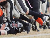 Connor Cook, Whitecourt Cats, gets piled on during a game against the Grande Prairie Warriors at Graham Acres field in Whitecourt, on Friday, Oct. 17. The Whitecourt Cats defeated Grande Prairie 66 - 7. Adam Dietrich | Whitecourt Star photo