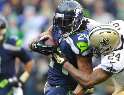 Seattle Seahawks running back Marshawn Lynch scores a touchdown against New Orleans Saints cornerback Corey White during the first half of the 2013 NFC divisional playoff football game at CenturyLink Field on January 11, 2014. (Steven Bisig/USA TODAY Sports)