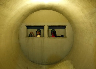 Helmets and gas masks are seen inside a secret bunker of Fascist leader Benito Mussolini that was built between 1942 and 1943 under his private residence at Villa Torlonia in Rome, October 25, 2014. The bunker will be open to the public on October 31, 2014. (REUTERS/Remo Casilli)