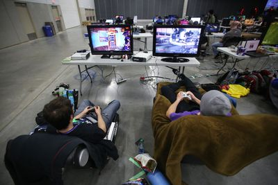 Chad Steeves, 25, left, and Kyle Marshall, 26, take part in the Extra Life charity event at the the Northlands Expo in Edmonton, AB on Saturday, October 25, 2014. Extra Life players participated in the 24-hour video game marathon to help raise money for Stollery Children's Hospital. TREVOR ROBB/EDMONTON SUN/QMI AGENCY