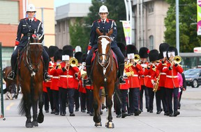 The Toronto Police Mounted Unit leads the parade during the opening ceremonies of the CNE in Toronto on Friday, August 15, 2014. (Dave Abel/Toronto Sun)