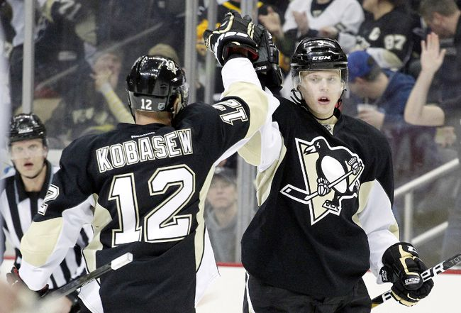 Pittsburgh Penguins defenceman Olli Maatta (right) celebrates with Chuck Kobasew after scoring against the Montreal Canadiens at the CONSOL Energy Center. (Charles LeClaire-USA TODAY Sports)