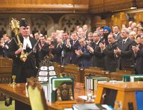 House of Commons sergeant-at-arms Kevin Vickers is applauded by MPs on Thursday, Oct. 23. Vickers is credited with stopping gunman Michael Zehaf-Bibeau after a gun battle had erupted within Parliament's halls the day before. Prior to getting into Parliament, Zehaf-Bibeau shot and killed Cpl. Nathan Cirillo at the National War Memorial. Photo Courtesy Jason Ransom
