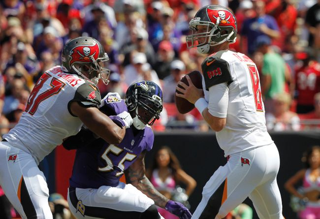 Tampa Bay Buccaneers quarterback Mike Glennon (8) prepares to throw the ball as Baltimore Ravens outside linebacker Terrell Suggs (55) defends during the first quarter at Raymond James Stadium on Oct 12, 2014 in Tampa, FL, USA. (Kim Klement/USA TODAY Sports)