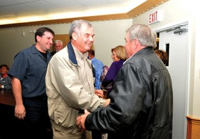 Acclaimed Elizabethtown-Kitley Township mayor Jim Pickard, centre, shakes the hand of re-elected councillor Earl Brayton. On the left is newcomer councillor Jason Barlow, who was the highest vote-getter in the township (ALANAH DUFFY/The Recorder and Times).