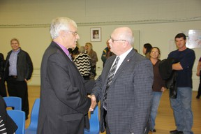 Pembroke mayor elect Michael LeMay is congratulated by outgoing mayor Ed Jacyno at the conclution of Monday's municipal election.