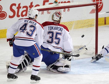 Nail Yakupov's (not pictured) gets past the Montreal Canadiens' goalie Dustin Tokarski (35) and Mike Weaver (43) during second period NHL action at Rexall Place, in Edmonton Alta., on Monday Oct. 27, 2014. David Bloom/Edmonton Sun/QMI Agency