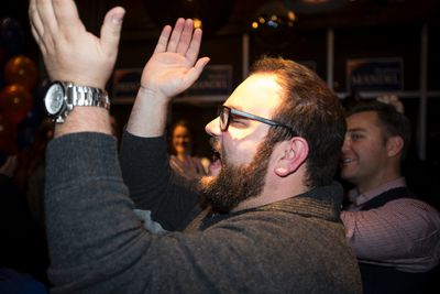 A supporter applauds Stephen Mandel after he won the Edmonton-Whitemud riding at Hart's Table & Bar in Edmonton, Alta., on Monday, Oct. 27, 2014. Stephen Mandel, Alberta's Health Minister, ran for election in former Premier Dave Hancock's old seat and won. Ian Kucerak/Edmonton Sun/ QMI Agency