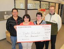 The Bank of Nova Scotia staff are pictured here, presenting a cheque for $5000.00 to Ducks Unlimited for conservation and wetlands projects, in order to match the funds raised at the Ducks Unlimited Banquet.. (L to R) Wes Moldowan, Dione Taylor, Kelly Mitchell and Tom Copeland.