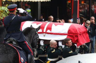The casket leaves the church. The funeral procession for Cpl. Cirillo draws more than 2,000 military personnel  Hamilton , Ont. on Tuesday October 28, 2014. Craig Robertson/Toronto Sun/QMI Agency