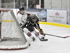 Paige Wards, right, of the Nor-Lan Chrysler Peace Country Midget AAA Storm and Treasure Posch, left, of the PAC Saints, get tangled while racing for the loose puck, in Alberta Major Midget Female Hockey League action at the Coca-Cola Centre on Saturday. The Storm won 3-1. LOGAN CLOW/DAILY HERALD TRIBUNE/QMI AGENCY