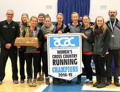 The GPRC Wolves Women's Cross-Country team were crowned champions at the 2014 ACAC Cross-Country Championships in Fort McMurray. Team member Mirelle Martens was first, followed by teammate Jamie Wigmore. Wolves' Jackie Benning and Amanda Patteson placed sixth and seventh. The team is coached by Bill Corcoran, left, and Bill Scott, right. The team's top four runners were named ACAC All Conference runners and will be representing GPRC and the ACAC at the CCAA National Championships in Calgary on Nov. 8. Robert Murray/QMI Agency