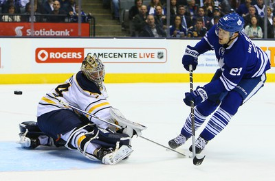James van Riemsdyk of the Toronto Maple Leafs hits the post behind Michal Neuvirth of the Buffalo Sabres during NHL action at the Air Canada Centre in Toronto on Tuesday October 28, 2014. Dave Abel/Toronto Sun/QMI Agency