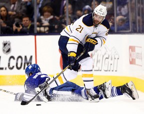 James van Riemsdyk of the Toronto Maple Leafs gets tripped by Drew Stafford of the Buffalo Sabres during NHL action on Oct. 28. (Dave Abel, Toronto Sun)