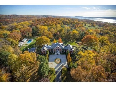 """Sleepy Hollow Mansion: """"Sleepy Hollow Road, the mythical byway that inspired the legend of the headless horseman, is the backdrop for this gory tale,"""" say the editors of TopTenRealEstateDeals.com. """"The Georgian manor, built in 1929 by architect to the wealthy, Mott Schmidt, for banker William S. Lambie is nestled on a secluded 16-acre parcel of land not far from the famed Hudson River. The house has no real tales of haunting within its walls. The price of this piece of architectural mastery has been reduced from $10.9 million to $9.8 million."""" (Courtesy TopTenRealEstateDeals.com)"""