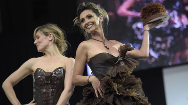 British TV host Louise Ekland (L) and French actress Adeline Blondieau present chocolate dresses during the Paris Chocolate fair (Salon du Chocolat) on October 28, 2014 in Paris.See more photos from the yummy fair.AFP PHOTO/MARTIN BUREAU