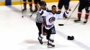 Guillaume Coude celebrates his easy fighting victory over Dylan Garrioch in the LNAH. (YouTube screen grab)