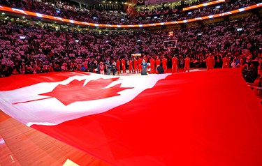 Toronto Raptors starting lineup against the Atlanta Hawks during the season opener NBA action at the Air Canada Centre in Toronto, Ont. on Wednesday October 29, 2014. Dave Abel/Toronto Sun/QMI Agency