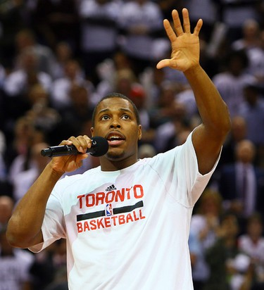 Kyle Lowry of the Toronto Raptors speaks to the Fans before action against the Atlanta Hawks during the season opener NBA action at the Air Canada Centre in Toronto, Ont. on Wednesday October 29, 2014. Dave Abel/Toronto Sun/QMI Agency