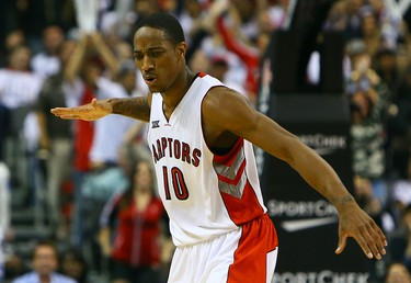 DeMar DeRozan of the Toronto Raptors celebrates 1st half lead against the Atlanta Hawks during the season opener NBA action at the Air Canada Centre in Toronto, Ont. on Wednesday October 29, 2014. Dave Abel/Toronto Sun/QMI Agency